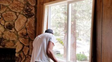 Man replacing the window