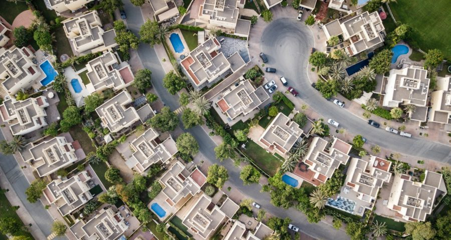 What are the hidden costs associated with real estate investment?